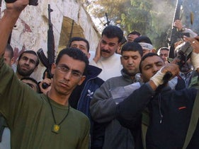 Raed Karmi (on the left) at a funeral in Tul Karm in 2001.