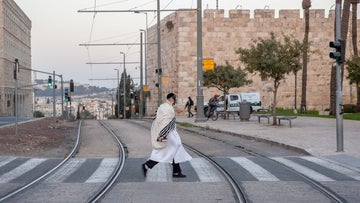 An ultra-Orthodox man walks in a Jerusalem street on the eve of Yom Kippur, September 27, 2020.