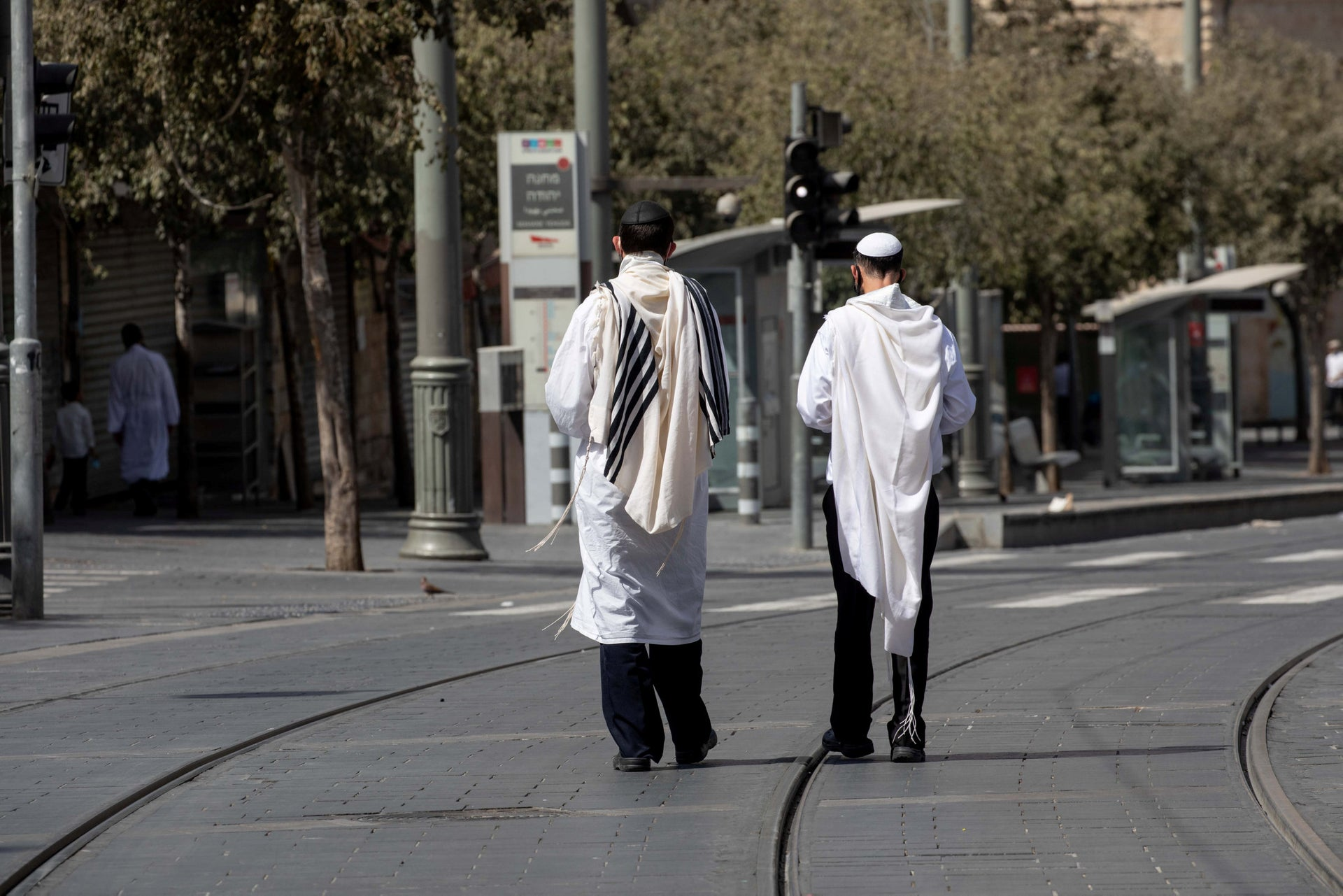 Ultra-Orthodox men walk in the streets of Jerusalem on Yom Kippur, September 28, 2020.