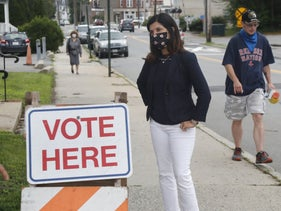 Democratic senatorial candidate Sara Gideon speaking to people near a polling station, July 14, 2020, in Portland, Maine.
