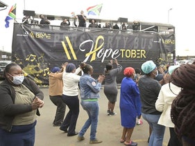 """Staff and patients gather at the Chris Hani Baragwanath Hospital listening to """"Songs for the Brave"""" performed by well known South African stage personalities in Soweto on September 22, 2020"""