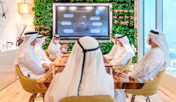 Emirati officials brief Sheikh Mohammed bin Rashid Al Maktoum about a possible moon mission, Dubai, United Arab Emirates, September 29, 2020.