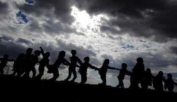 Syrian children who were displaced with their family from eastern Aleppo play in the village of Jibreen south of Aleppo, Syria, December 3, 2016.