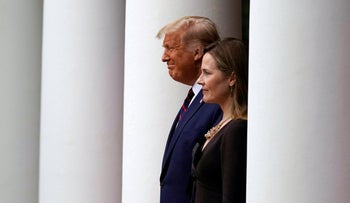 President Donald Trump walks with Judge Amy Coney Barrett to a news conference to announce Barrett as his nominee to the Supreme Court, at the White House. Sept. 26, 2020