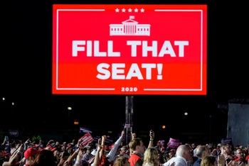 Supporters cheer U.S. President Donald Trump under a sign calling for the filling of the vacant Supreme Court seat with Amy Coney Barrett at a campaign event in Middletown, Penn. Sept 26, 2020