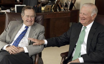 Former President George H.W. Bush, left, and former Secretary of State James A. Baker III talking about the Gulf War and liberation of Kuwait, during an interview January 18, 2011, in Houston.