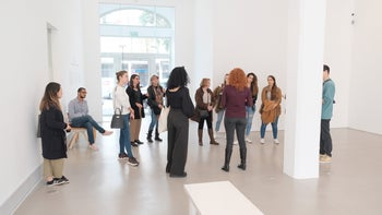 People participate in an art tour at the Magasin III gallery in Jaffa, 2020.
