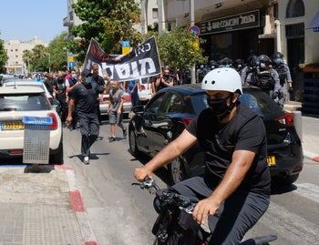 Jaffa residents protest the demolition of a Muslim burial ground in Jaffa, in June 2020.