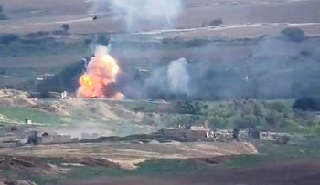 This image taken from a video released by Armenian Defense Ministry on Monday, Sept. 28, 2020 allegedly shows fighting between Armenian and Azerbaijani forces at the contact line of the self-proclaimed Republic of Nagorno-Karabakh, Azerbaijan
