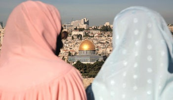 Two veiled women viewing the Dome of the Rock.