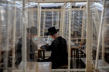 An ultra-Orthodox Jewish man attended a synagogue with social distancing measures in place in Mea She'arim, Jerusalem, September 24, 2020.