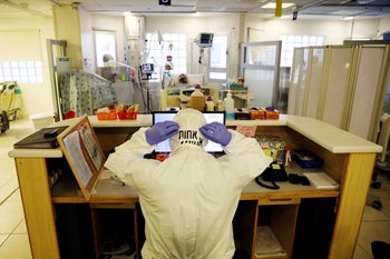A hospital staffer fixes her protective suite at a coronavirus ward at Ichilov Hospital, Tel Aviv, September 21, 2020.