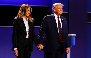 U.S. President Donald Trump and first lady Melania Trump leave the stage at the conclusion of the first presidential debate with Democratic presidential nominee Joe Biden, September 29, 2020.