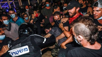 Police arrest a demonstrator against the amendment to the Corona Law in Tel Aviv, September 29, 2020.