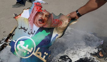 Palestinians burn a poster depicting Bahrain's King Hamad bin Isa Al Khalifa and Israeli Prime Minister Benjamin Netanyahu during a protest against normalizing relations. Gaza, Sept 15, 2020
