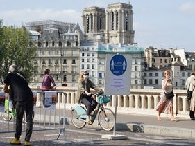 People pass by on a street in Paris amid the COVID-19 pandemic, September 12, 2020.