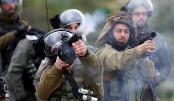 Israeli soldiers fire tear gas canisters towards Palestinian demonstrators during a protest against President Donald Trump's Mideast initiative, in the Jordan Valley, West Bank, February 25, 2020.