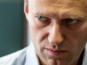Russian opposition leader Alexei Navalny stands during a break in the hearing on his appeal in a court in Moscow, Russia, 2018.