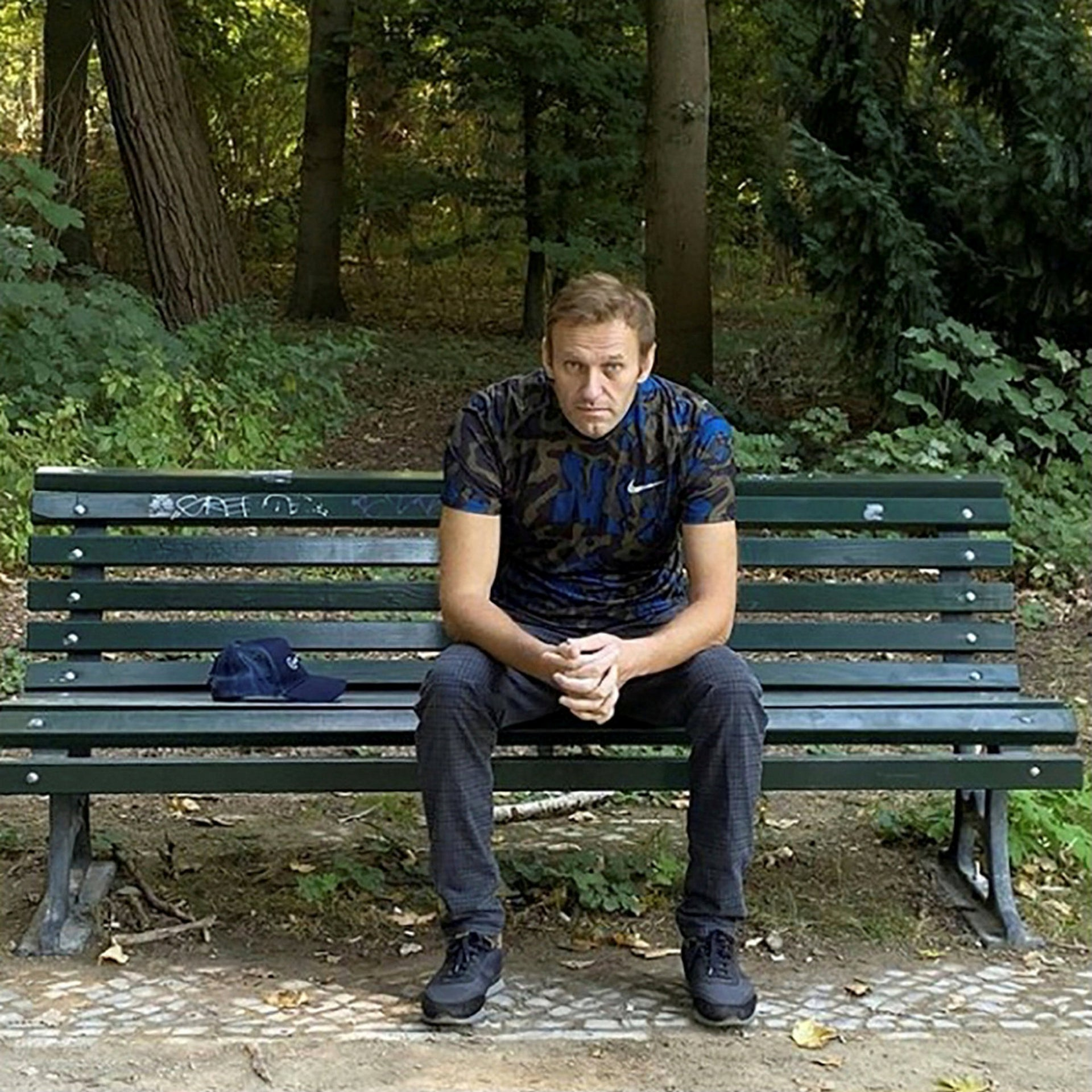 Navalny sits on a bench while posing for a picture in Berlin, Germany, in this undated image obtained from social media September 23, 2020.