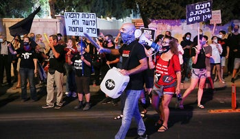 Demonstrators marching in Tel Aviv against the government decision to restrict protests, September 30, 2020.