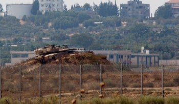 An IDF tank guards during maintenance work on the Gaza border fence, September 1, 2020.