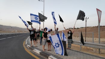 Protesters gather at Kibbutz Grofit in southern Israel, October 1, 2020.
