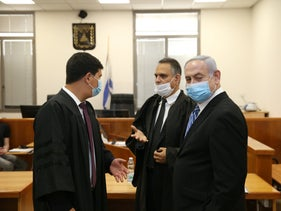 Prime Minister Netanyahu, right, at the Jerusalem District Court.