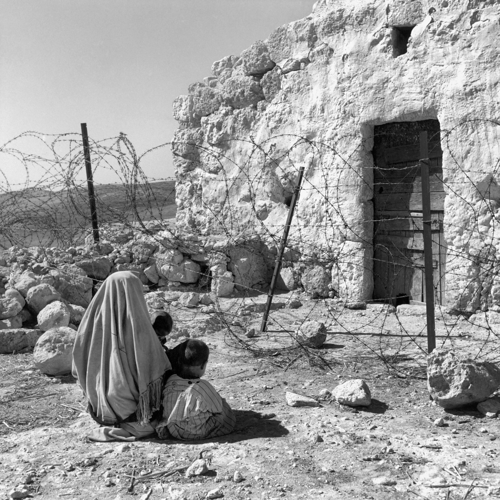 A Palestinian refugee cut off from her home by the 1949 Armistice Line (Green Line), which was established after the Arab-Israeli war in 1948.