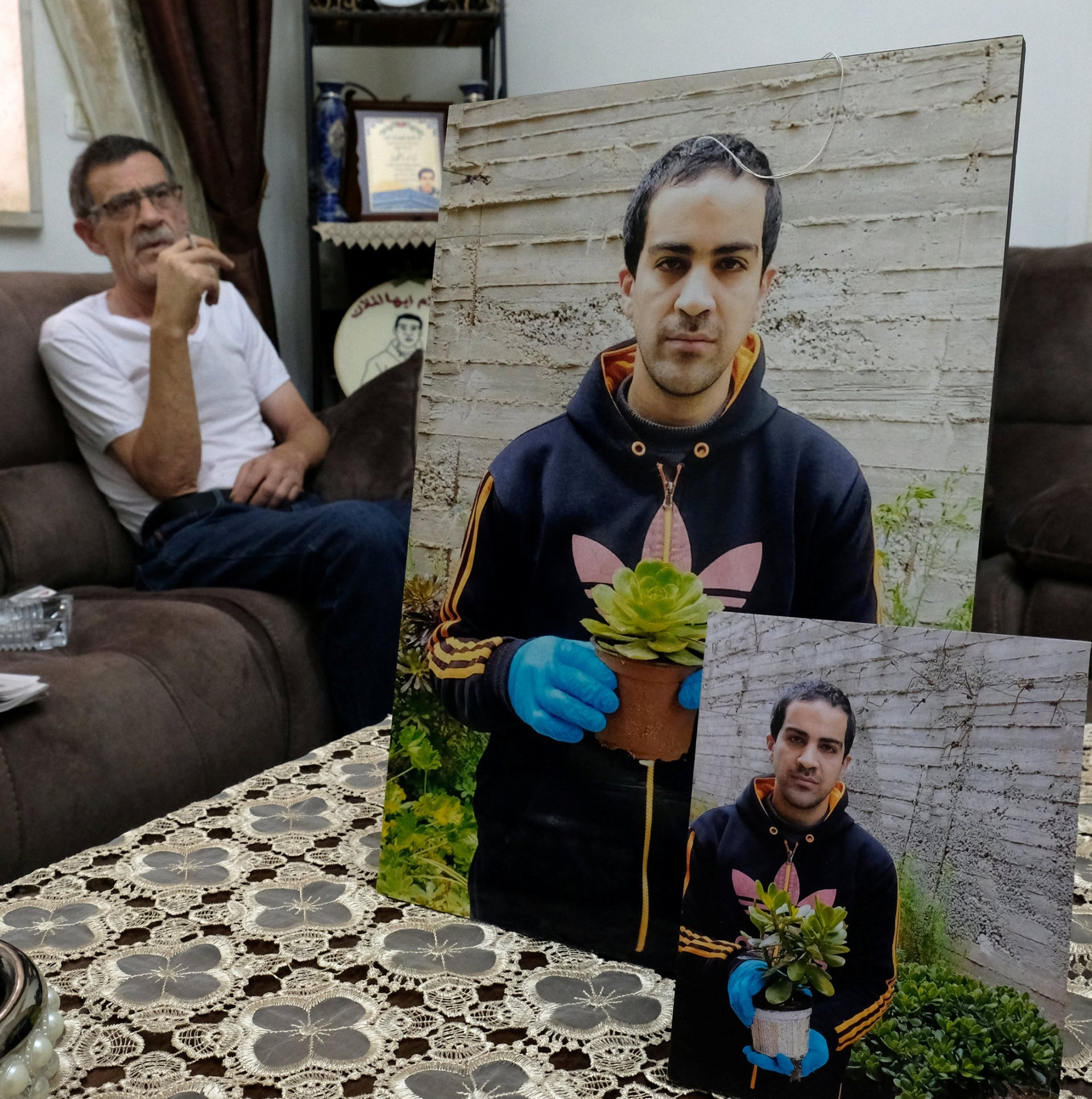 Khairy Hallaq at home, with photos of his son, Eyad.