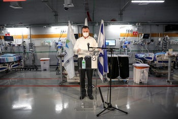 Health Minister Yuli Edelestein during a visit to the Sheba medical center in central Israel, June 23, 2020. Doctors blast decision makers for not seeing the real situation.