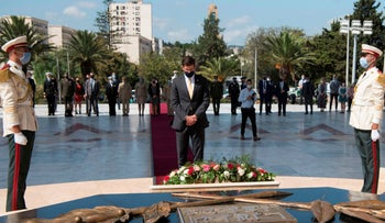 In this photo released by the U.S. Department of Defense, U.S. Defense Secretary Mark Esper bows his head after laying a wreath at the Monument of the Martyr in Algiers, Algeria, October 1, 2020