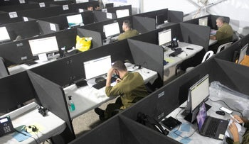 File photo: Soldiers at an epidemiological investigations call center in Ramle, August 5, 2020.