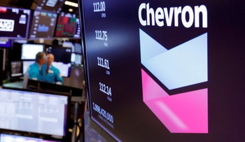 The logo for Chevron appears above a trading post on the floor of the New York Stock Exchange, October 8, 2019.