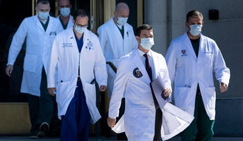 White House physician Sean Conley (2nd R), with medical staff, arrives to give an update on the condition of US President Donald Trump, on October 3, 2020.