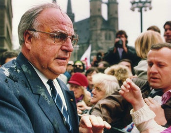 German Chancellor Helmut Kohl looking dismayed after being hit by eggs in Halle, eastern Germany, May 10, 1991. Detlev Rohwedder had been assassinated the previous month.