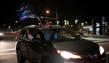 Supporters of President Donald Trump drive past an entrance to Walter Reed National Military Medical Center in Bethesda, Md., Sunday, October 4, 2020.