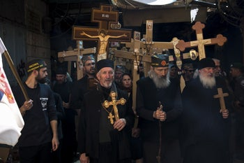 Orthodox Christian pilgrims leading a procession in the Old City of Jerusalem