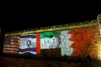 National flags of Bahrain, UAE, Israel and the U.S. are projected on the walls of Jerusalem's Old city September 15, 2020