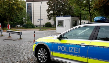 A police car stands in front of the Synagogue 'Hohe Weide' in Hamburg, northern Germany, on October 5, 2020.