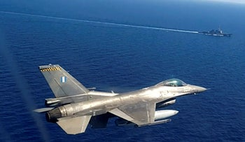 Greek air force jet takes part in a Greek-US military exercise south of the island of Crete, on Monday, Aug. 24, 2020