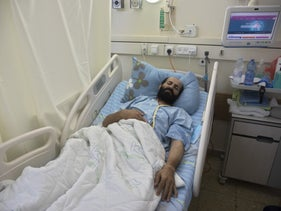 Maher Akhras is seen in a hospital bed in Kaplan Hospital, September 29, 2020.