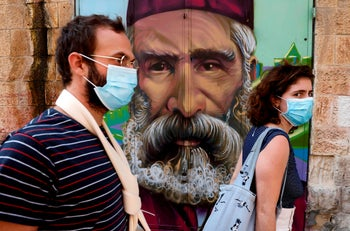 Shoppers at the Mahane Yehuda market in Jerusalem on September 24, 2020, a day ahead of a nationwide lockdown aimed at curbing a surge in coronavirus cases.