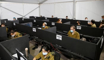Home Front Command soldiers perform contact tracing at the command headquarters in Ramle, September 29, 2020.