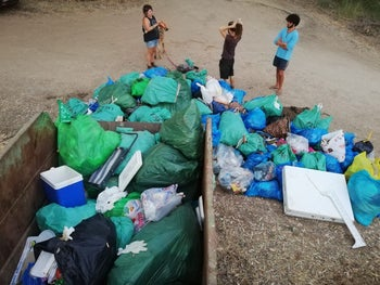 Volunteers collecting litter at Banias Stream in the Golan Heights.