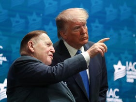 U.S. President Donald Trump standing alongside Sheldon Adelson before delivering remarks at the Israeli American Council National Summit in Hollywood, Florida, December 7, 2019.