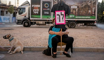 A Black Flag protester holding a sign reading 'go' at a demonstration in line with Health Ministry guidelines against Prime Minister Benjamin Netanyahu, Jerusalem, October 6, 2020.