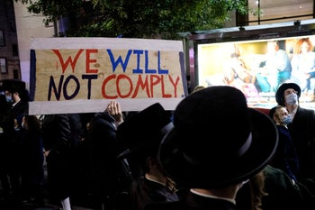 Ultra-Orthodox Jews gather in the Borough Park neighborhood of Brooklyn to protest against COVID-19 restrictions in New York. October 7, 2020