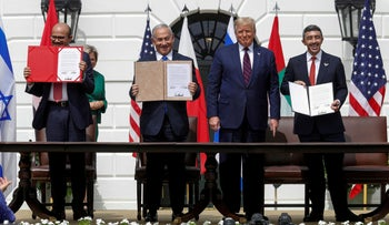 Bahrain's foreign minister, Israel's Netanyahu and UAE foreign minister display signed agreements while Trump looks during the Abraham Accords signing ceremony, White House, September 15, 2020.