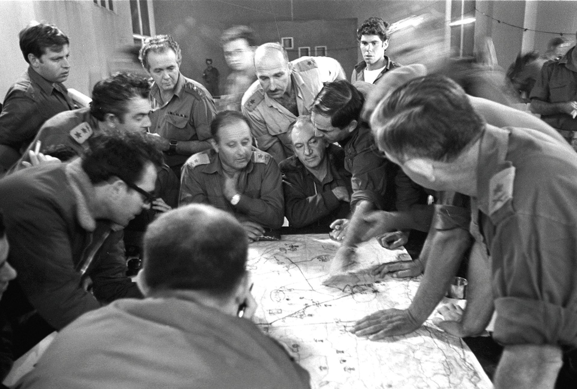 Motti Hod, center (with mustache), and Haim Bar-Lev (seated in front of him), during a discussion of senior officers at Northern Command command post.
