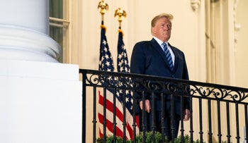U.S. President Donald Trump at the Truman Balcony of the White House as he returns to the White House after being hospitalized at Walter Reed Medical Center, October 5, 2020.